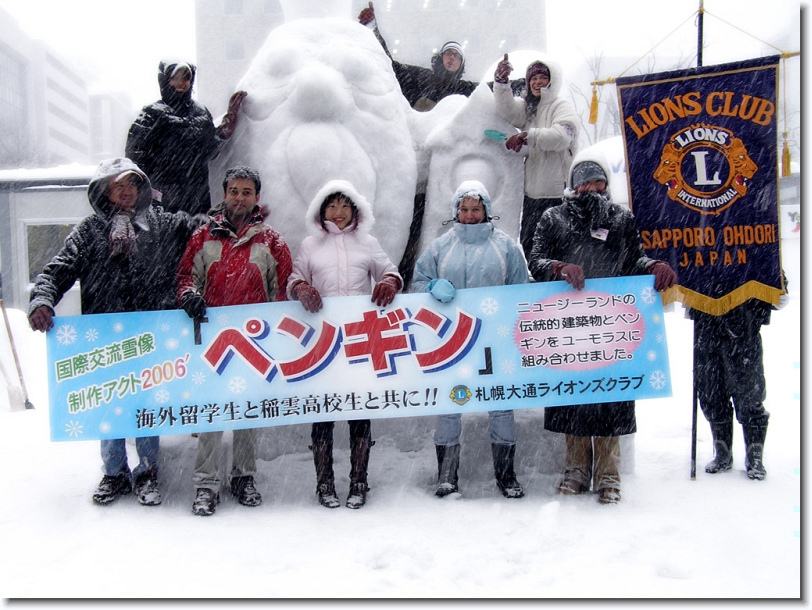penguin. lions club sapporo and hokkaido university international students at sapporo snow festival